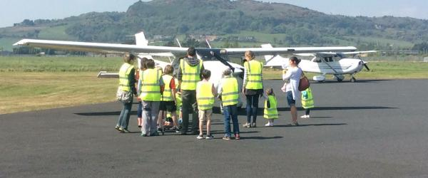 Visit to Ulster Flying Club- children with plane