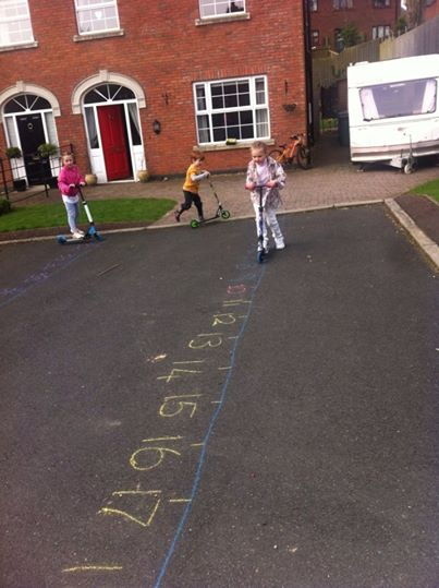 Children learning maths by cycling over a large number line