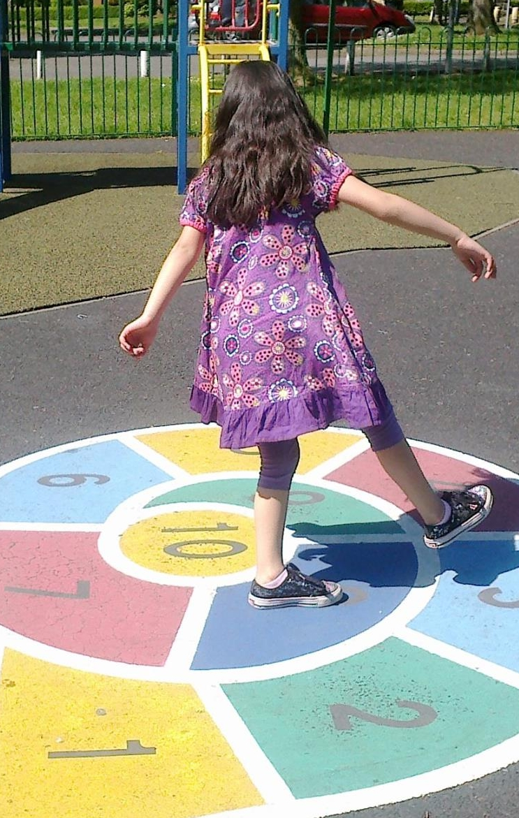 Girl plays on a numberline at a playpark