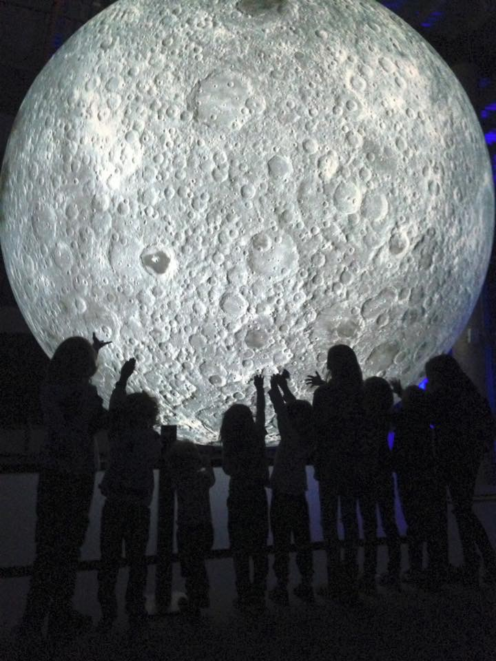 HEdNI trip to Moon Exhibit - Silhouettes of children in front of a large moon