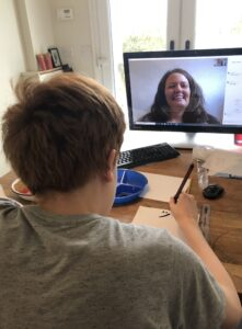 Teenager studying for Japanese GCSE with support of online tutor